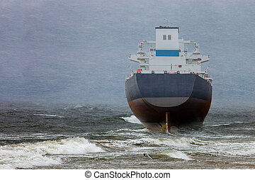 Ship in blizzard - Oil tanker in a winter storm day during a...