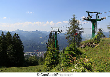 Chairlift with mountains in the background