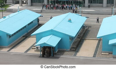 tourists on the border of North Korea and South Korea -...