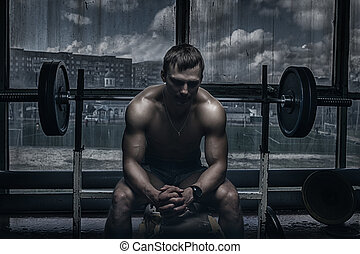 Athlete in old rusty gym - Young handsome athlete in old...