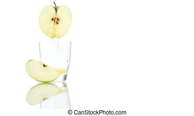 apple juice poured into the glass isolated on white...