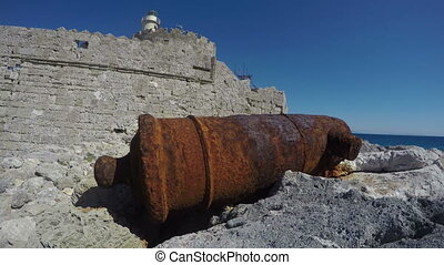 rusty cannon Rhodes fort - Old rusty medieval cannon near...