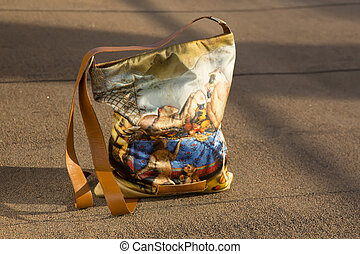 women bag with color print on street