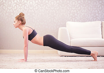 Woman is going to do press-ups - Strong body Beautiful young...