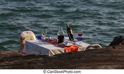 view of restaurant table served at sand beach against sea