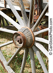 Old Wagon Wheel - Old rusty wagon wheel with weathered...