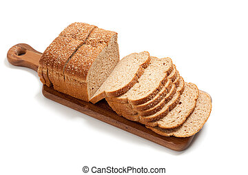 Loaf of whole grain bread on a board