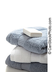 White and blue towels with soap on white - White and blue...