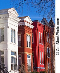 Colorful brick townhouses of Washington DC. Brick row houses at sunset in winter.