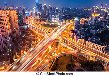 city interchange at night , overpass and viaducts in...