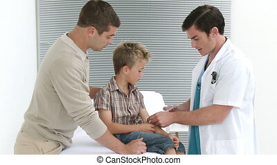Doctor giving a little kid an injection - Footage in high...