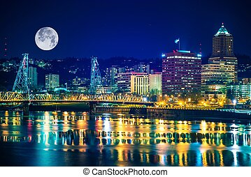 Portland Skyline with Moon and the Willamette River Downtown...