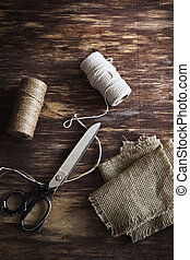 old tailoring scissors and supplies for sewing on an old...