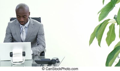 Businessman talking to a colleague in his office