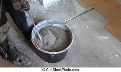 man mix cement - worker builder mix cement in bucket....