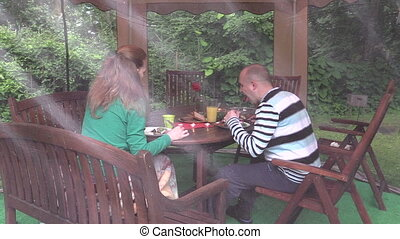 couple eat meat gazebo - couple eat backed on grill meat at...