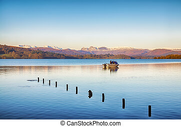 Fishing on Windermere - Two people fishing from a small boat...