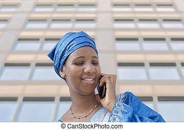 Afro beauty, traditional headscarf - Afro beauty wearing a...