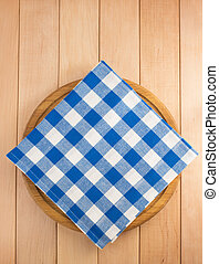 napkin at cutting board on wooden background