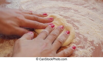 Making Pastry Dough for Cake. A baker rolling dough - Making...