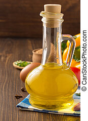 oil and food ingredients, spice on wooden background