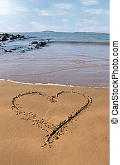 sand love heart - a romantic love heart inscribed on the...