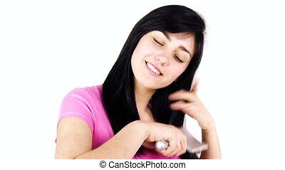 Woman desperate about loosing hair - Woman brushing long...