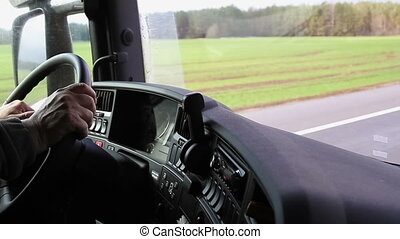 Driver hands on steering wheel control truck or lorry