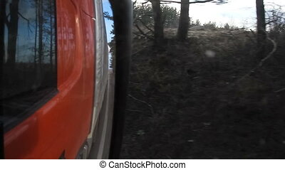 View from rear-view mirror of truck or lorry