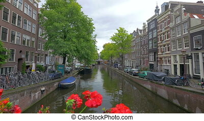 Canal in Amsterdam, Holland, 4k UHD - AMSTERDAM - August 25,...