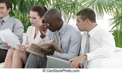 Bored business people in a waiting room - Bored multi-ethnic...