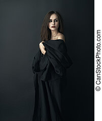 girl in black dress on a dark background - girl in a black...