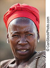 African woman - portrait senior African woman with headscarf...