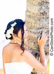 beautiful young bride in a white wedding dress with bouquet...