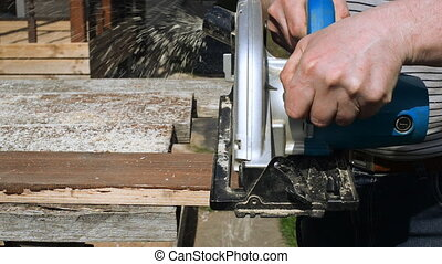 Handyman using hand-held saw - Handyman using hand-held saw...