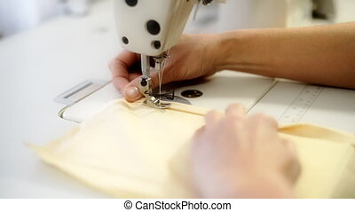 Female hands sewing. - Female hands sewing on professional...