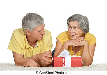 Happy older couple with gift - Portrait of a Happy older...