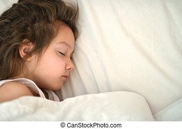Girl sleeping in bed - Portrait of a cute little girl...