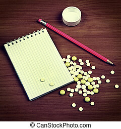 Writing Pad and the Pills - Toned Photo of Writing Pad and...