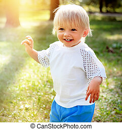 Happy Child outdoor - Toned Photo of Happy Child in the...