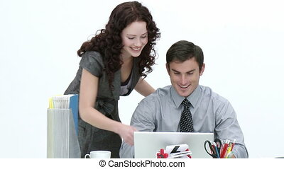 Business associates working together in and office...