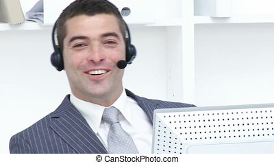 Attractive businessman working in a call center - Attractive...