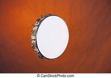 Tambourine Isolated on Gold - A wood tambourine isolated...