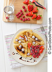 Pancakes with homemade balsamic reduction and fresh fruit,...