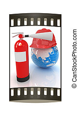 Red fire extinguisher and hardhat on earth. The film strip -...