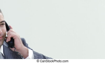 Close-up of businessman talking on phone in office