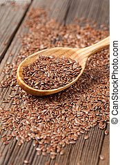 Natural raw flax seeds nutritious food in spoon on wooden...
