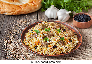 Arabic traditional rustic rice food pilaf cooked with fried...