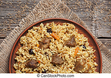 Bowl of arabic national rice food pilaf with fried meat,...