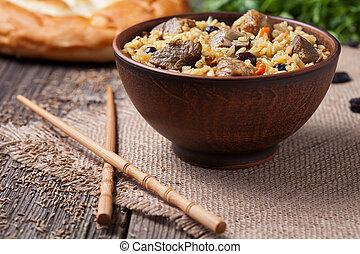 Traditional healthy asian national spicy rice food pilaf...